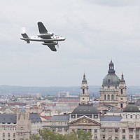 Li2 old-timer plane performs during an air show above river Danube crossing central Budapest, Hungary on May 01, 2016. ATTILA VOLGYI
