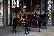 London 14th November 2015. A senior police officer  before the Lord Mayor's Show in the City of London, the capital's ancient financial district founded by the Romans in the 1st Century. This is the pageant's 800th birthday and the 250 year-old horse-drawn guided State Coach will be pulled through the medieval streets with the newly-elected Mayor along with 7,000 others. This first took place in 1215 making it the oldest and longest civil procession in the world which survived both Bubonic plague and the Blitz. Richard Baker / Alamy Live Newb