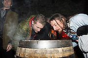 Crowd taking a whiff of a barrel charred by 5th Generation Jameson Master Cooper Ger Buckley  at The Jameson The Black Barrel Craft Series  at Old printing works, Market Street with music by Corner boy.  Photo:Andrew Downes