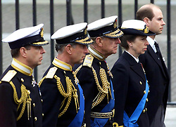File photo dated 09/04/02 of members of Britain's Royal family following the coffin of the Queen Mother on its way to her funeral in Westminster Abbey in London, (L-R) the Duke of York, Prince of Wales, Duke of Edinburgh, Princess Royal, and Earl of Wessex. He was the Queen's husband and the royal family's patriarch, but what will the Duke of Edinburgh be remembered for? Issue date: Friday April 4, 2021.