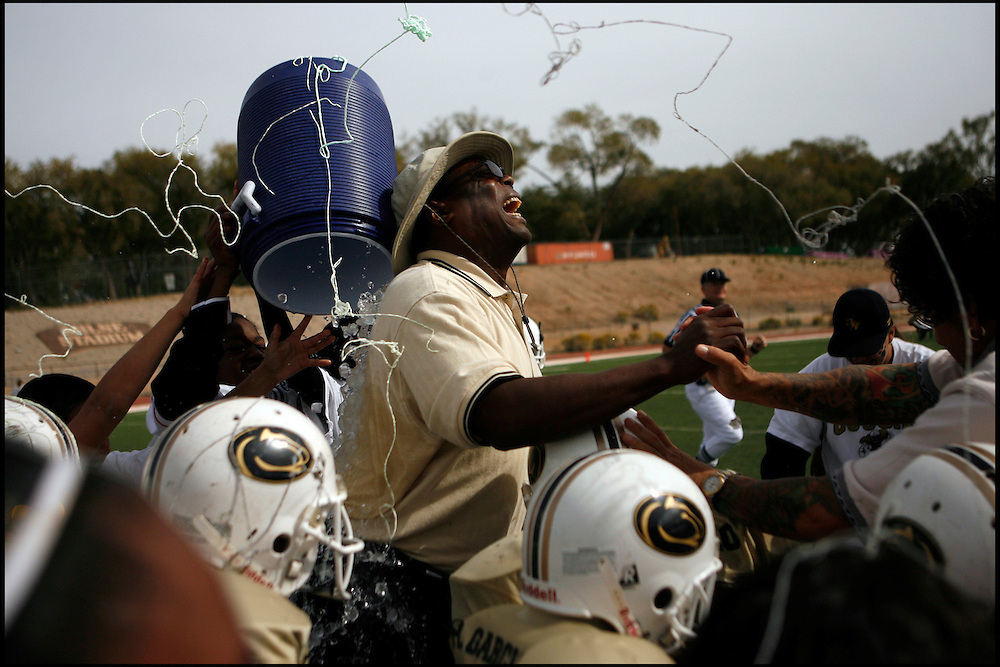 .In the rookie division, Cibola South head coach Vince Peele gets hit with the water bucket following his teams victory on Sunday at Milne Stadium.