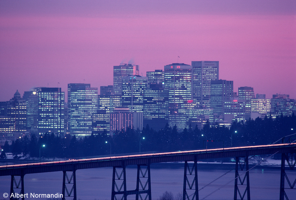 View of city at night with Lions Gate Bridge tight