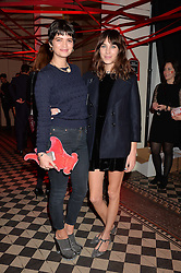 Left to right, PIXIE GELDOF and ALEXA CHUNG at the Tunnel of Love art and fashion auction and dinner in aid of the British Heart Foundation held at One Mayfair, London on 12th November 2013.