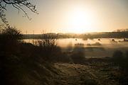 Frosty winter morning mist landscape at sunrise in Olney, England, United Kingdom.