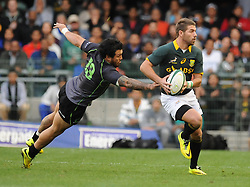 Image ©Licensed to i-Images Picture Agency. 07/06/2014. CAPE TOWN, SOUTH AFRICA - Willie le Roux of South Africa dodges a flying Rene Ranger of the World XV during the Castle Lager Incoming Series rugby tour match between the Springboks and the World XV at Newlands rugby stadium. Picture by Roger Sedres / i-Images