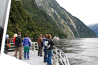 Milford Sound is New Zealand's top tourist destination. It was described by Rudyard Kipling as the Eigth Wonder of the World. Geographically it is not a sound but a fijord. It is 15 kilometres long and its sheer rock interfaces rise to 1200 metres. 201004055024..© Victor Patterson, 54 Dorchester Park, Belfast, N Ireland. Tel: +44 2890661296; Mobile: +44 7802 353836; Emails: victorpatterson@me.com & victorpatterson@gmail.com; www.victorpatterson.com