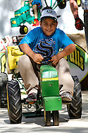 Armando Torres, 8, pedals hard in the kid's tractor pull at the Contra Costa County Fair in Antioch on Sunday, June 3, 2012.  (Photo by Kevin Bartram)