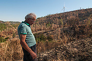 Adolfo Gustavo Berlingieri, owner with his family of a large natural area in Crotone, looks at his burned wood on August 03, 2017 in Crotone, Italy. An intense heatwave is sweeping across many regions of Italy, prompting local councils to issue a number of high level alerts. The province of Crotone has suffered much damage due to the fires over the last few weeks. ©Simone Padovani