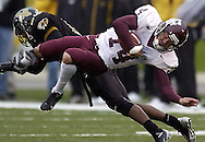 Texas A&M receiver Chad Schroeder is hit by a Univeristy of Missouri defender after a 16-yard reception for a first down during the first quarter on Saturday, Nov. 15, 2003 in Columbia, Mo. (Photo by Kevin Bartram)