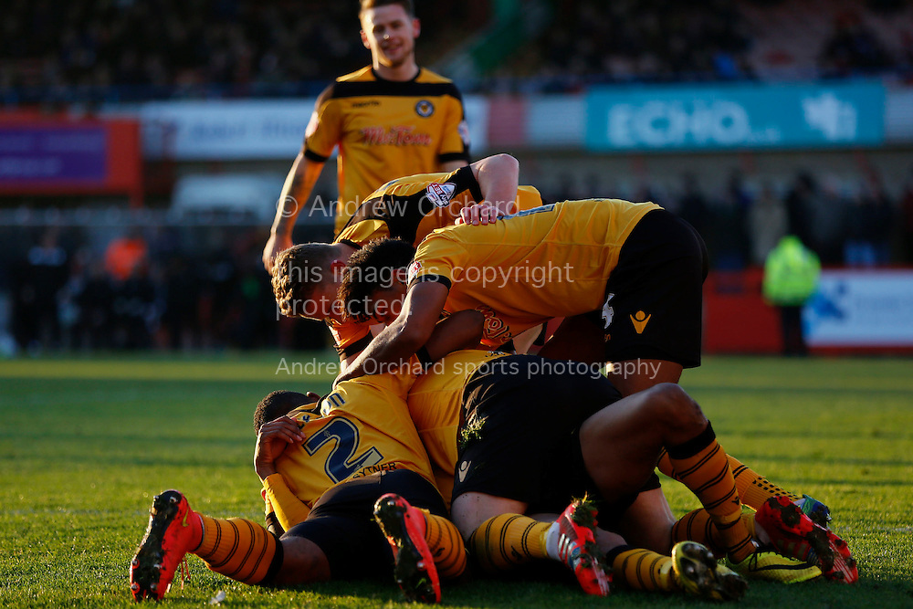 Chris Zebroski of Newport County is mobbed by team mates after scoring his side's first goal.<br /> Skybet football league two match, Cheltenham Town  v Newport County at The Abbey Business Stadium, Whaddon Road in Cheltenham, Glos on Sunday 28th December 2014.<br /> pic by Mark Hawkins, Andrew Orchard sports photography.