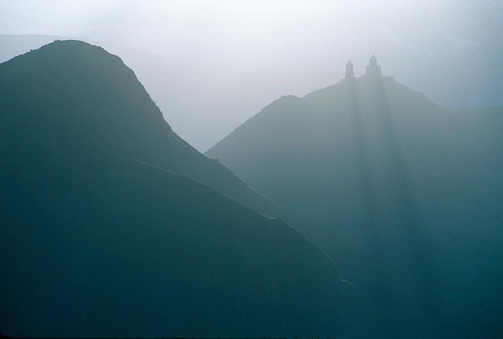 Gergeti Trinity Church (Tsminda Sameba) near Mount Kazbek, afternoon haze, April, Caucasus Mountains, The Country of Georgia