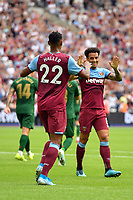 Football - 2019 Betway Cup (pre-season friendly) - West Ham vs. Athletic Bilbao<br /> <br /> West Ham United's Felipe Anderson congratulates Sebastien Haller after Jack Wilshere scores his side's equalising goal to make the score 2-2, at The London Stadium.<br /> <br /> COLORSPORT/ASHLEY WESTERN