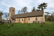 Graves in churchyard of Saint Botolph church, North Cove, Suffolk, England, UK