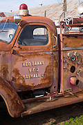 Abandoned rusty fire truck engine at The Shack Up Inn cotton sharecroppers theme hotel, Clarksdale, Mississippi, USA