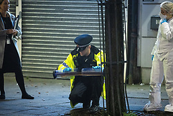 © Licensed to London News Pictures. 05/11/2020. Manchester, UK. Evidence gatherers work with police at the scene . A 16 year old boy has been stabbed to death this evening (5th November 2020) . Police and crime scene investigators have taped off several streets around Birchenall Street in Moston , North Manchester , as investigations are carried out . Photo credit: Joel Goodman/LNP
