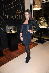 LULU KENNEDY at a party for TACH jewellery held at Tach, 13 Grafton Street, London on 10th December 2009.