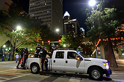 A pickup truck carries Charlotte police officers through the streets of the city as they follow a protest march in Charlotte, NC, USA, on Friday, September 23, 2016, as demonstrations continue following the shooting death of Keith Scott by police earlier in the week. Photo by Jeff Siner/Charlotte Observer/TNS/ABACAPRESS.COM