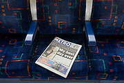 A Metro newspaper on a London underground tube train seat with the Olympic ambassador and rioter story on page 1. This free paper given to tube and rail commuters features the story of an Olympic ambassador, a teenage girl chosen to represent the 2012 Olympiad but who was found to have looted a small business herself. Over a four-day period in August 2011, Britain was held in the grip of social and criminal unrest when the (mostly) young went on the rampage, looting and stealing from shops and stores. In total 6 people died but many of hundreds of small businesses was ransacked for their stock. Desirable clothing accessories from sports shops as well as food and alcohol were rifled from convenience stores. Approximately 3,000 arrests were made across cities and towns across the Uk – mostly in London.