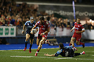 DTH van der Merwe of the Scarlets breaks past Kirby Myhill of Cardiff Blues. Guinness Pro12 rugby match, Cardiff Blues v Scarlets at the BT Cardiff Arms Park in Cardiff, South Wales on Friday 28th October 2016.<br /> pic by Andrew Orchard, Andrew Orchard sports photography.