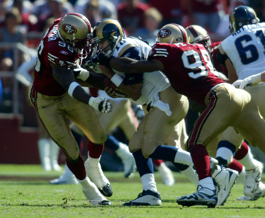 San Francisco 49ers defenders Andre Carter, left, and Julian Peterson (98) sack St. Louis Rams Marc Bulger in the fourth quarter of an NFL football game, Sunday, Sept. 11, 2005 at Candlestick Park in San Francisco. (D. Ross Cameron/the Oakland Tribune)