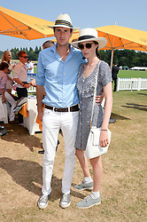 OTIS FERRY and EDIE CAMPBELL at the Veuve Clicquot Gold Cup, Cowdray Park, Midhurst, West Sussex on 21st July 2013.