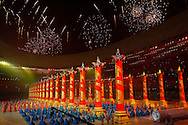 BEIJING, CHINA:  Fireworks go off above as hundreds  of Chinese dancers perform inside the National Stadium during the 2008 Olympiad Opening Ceremony in Beijing, China on Friday, 8/8/08. Thousands of athletes from all over the world marched in the stadium representing their various countries.  ©2008 Johnny Crawford