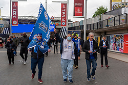 © Licensed to London News Pictures. 15/05/2021. London, UK. Leciester City football fans arrive at Wembley Stadium to attend the Emirates FA Cup Final between Chelsea football club and Leicester City football club. All attendees have to show evidence of a negative Covid-19 test to attend the event as part of the Events Research Programme (ERP) pilot scheme informing the government's decision on step 4 of its roadmap out of lockdown. Photo credit: Ray Tang/LNP