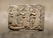 Photo of Hittite monumental relief sculpted orthostat stone panel of a Procession Limestone, Karkamıs, (Kargamıs), Carchemish (Karkemish), 900-700 B.C. Anatolian Civilisations Museum, Ankara, Turkey.<br /> <br /> It is a depiction of three marching female figures in long dress with a high headdress at their head. These women are considered to be the nuns of the Goddess Kubaba. The figures in the front and behind have a round mirror in their right hand while the figure in the middle has a bunch of spica in her right hand. Figures carry objects similar to a sceptre in their left hand.  <br /> <br /> Against a brown art background. .<br />  <br /> If you prefer to buy from our ALAMY STOCK LIBRARY page at https://www.alamy.com/portfolio/paul-williams-funkystock/hittite-art-antiquities.html  - Type  Karkamıs in LOWER SEARCH WITHIN GALLERY box. Refine search by adding background colour, place, museum etc.<br /> <br /> Visit our HITTITE PHOTO COLLECTIONS for more photos to download or buy as wall art prints https://funkystock.photoshelter.com/gallery-collection/The-Hittites-Art-Artefacts-Antiquities-Historic-Sites-Pictures-Images-of/C0000NUBSMhSc3Oo