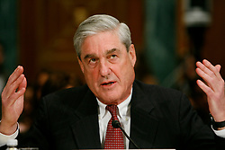 May 17, 2017 - FILE PHOTO - The Justice Department on Wednesday named ROBERT MUELLER as special counsel to oversee the department's investigation into Russian meddling in the 2016 election. Mueller III served as FBI director from 2001 through 2013. Pictured: Mar. 30, 2011 - Washington, D.C, U.S. - FBI Director ROBERT MUELLER testifies before the Senate Judiciary Committee hearing on ''Oversight of the Federal Bureau of Investigation. (Credit Image: © James Berglie/ZUMAPRESS.com)