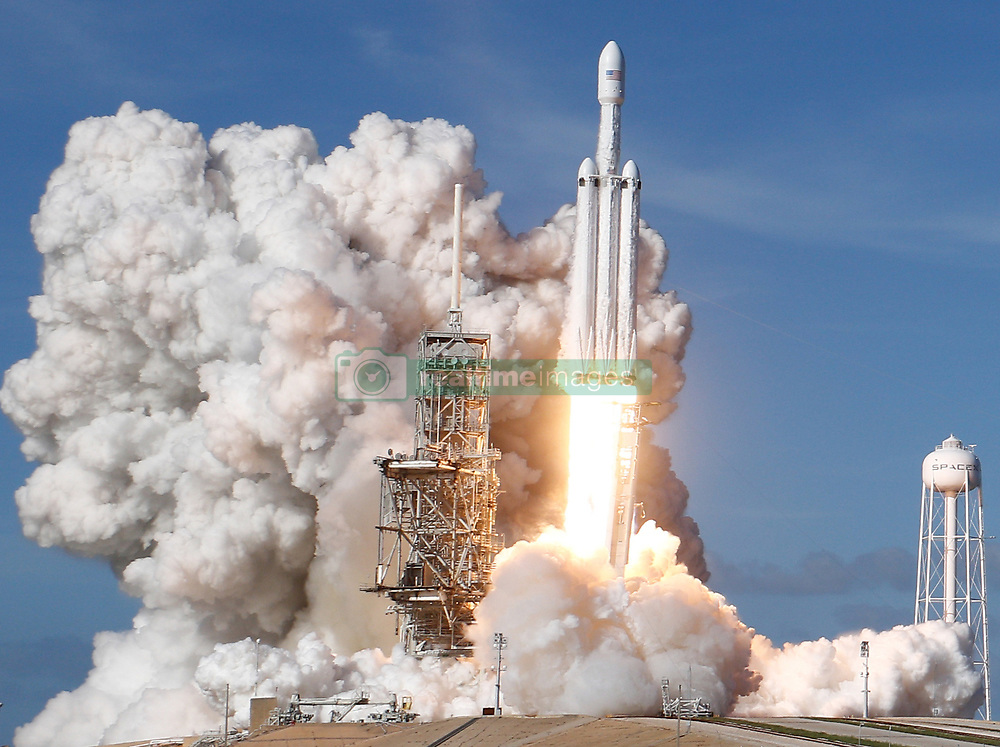 2-6-18. KSC  FL. SpaceX's first Falcon Heavy rocket lifts off on its inaugural test launch from NASA's Kennedy Space Center in Florida at 3:45 p.m. EST (2045 GMT). The high-power launcher is attempting to boost Elon Musk's electric Tesla sports car into deep space as a shakedown for future Falcon Heavy missions. Photo by Gene Blevins/LA DailyNews/SCNG/ZumaPress. (Credit Image: © Gene Blevins via ZUMA Wire)