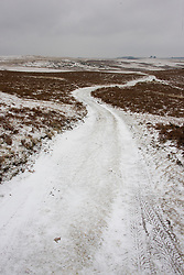 © Licensed to London News Pictures. 13/02/2021. Builth Wells, Powys, Wales, UK. A bitterly cold landscape as strong south east winds and snow hit Mid Wales with temperatures minus 4.5 deg C and 'feels like' temperature around minus 10-15 deg C at 400 metres (1,300 feet) above sea-level on the Mynydd Epynt range near Builth Wells in Powys, Wales, UK. Photo credit: Graham M. Lawrence/LNP