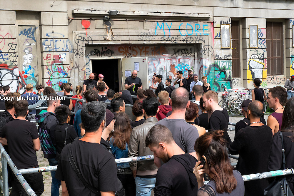 People queuing to enter  Berghain nightclub on a Sunday afternoon in Berlin Germany - - Editorial Use Only