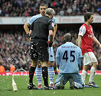 Premier League Arsenal v Manchester City<br />Red card for Mario Balotelli a bottle is thrown onto the pitch by Man City fans