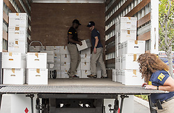 June 7, 2017 - Irvine, CA, USA - Agents from the FBI and the Office of Inspector General of the Department of Health and Human Services (HHS OIG) execute a warrant and load boxes of evidence gathered from the offices of Proove Bioscience in Irvine on Wednesday, June  7, 2017. (Credit Image: © Leonard Ortiz/The Orange County Register via ZUMA Wire)