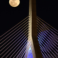 Boston landmark photography of the rising full moon over the historic Boston Zakim Bridge in Charlestown Massachusetts. <br /> <br /> Super moon is the next step up and the next one is expected 14 November 2016. A supermoon is known as a new or full moon occurring at the same time the moon comes within 90 percent of its closest approach to Earth in a given orbit. It is an astronomical event that happens 4-6 times a year, but according to a NASA Science News story, last nights full moon nearly coincided with the moon's arrival at its closest point in its orbit around the Earth, resulting in the biggest, visible full moon in North America in two decades.<br /> <br /> Boston landmarks with full moon photography images are available as museum quality photography prints, canvas prints, acrylic prints or metal prints. Fine art prints may be framed and matted to the individual liking and decorating needs:<br /> <br /> http://juergen-roth.pixels.com/featured/full-moon-across-boston-bunker-hill-bridge-juergen-roth.html<br /> <br /> All Boston skyline photography images are available for digital and print image licensing at www.RothGalleries.com. Please contact me direct with any questions or request.<br /> <br /> Good light and happy photo making!<br /> <br /> My best,<br /> <br /> Juergen<br /> Prints: http://www.rothgalleries.com<br /> Photo Blog: http://whereintheworldisjuergen.blogspot.com<br /> Instagram: https://www.instagram.com/rothgalleries<br /> Twitter: https://twitter.com/naturefineart<br /> Facebook: https://www.facebook.com/naturefineart