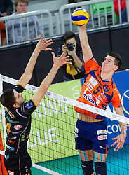 Luigi Salvatore Randazzo of Macerata vs Alen Sket of ACH during volleyball match between ACH Volley and Lube Banca Marche Macerata (ITA) in 5th Leg of Pool D of 2013 CEV Champions League on December 5, 2012 in Arena Stozice, Ljubljana, Slovenia. ACH defeated Macerata 3-1. (Photo By Vid Ponikvar / Sportida)