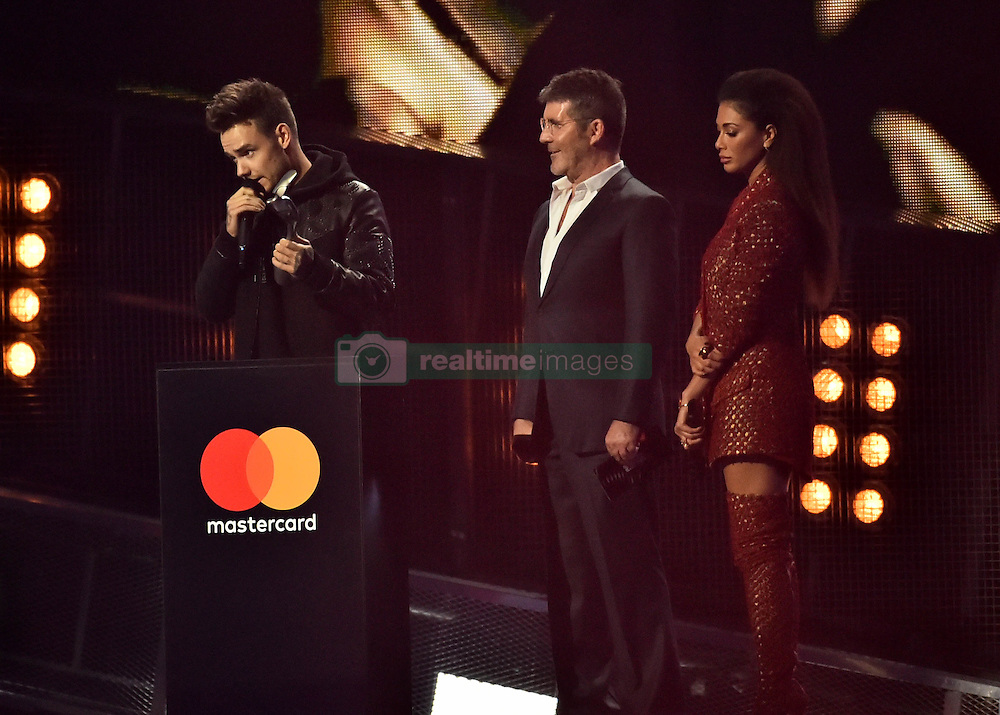 Liam Payne with the Best British Video Award with Simon Cowell and Nicole Scherzinger on stage at the BRIT Awards 2017, held at The O2 Arena, in London.<br /><br />Picture date Tuesday February 22, 2017. Picture credit should read Matt Crossick/ EMPICS Entertainment. Editorial Use Only - No Merchandise.