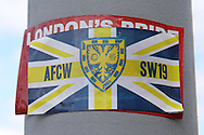 Sticker of AFC Wimbledon outside The Cherry Red Records Fans' Stadium before k/o. Skybet football league two play off semi final, 1st leg match, AFC Wimbledon v Accrington Stanley at the Cherry Red Records Stadium in Kingston upon Thames, Surrey on Saturday 14th May 2016.<br /> pic by John Patrick Fletcher, Andrew Orchard sports photography.