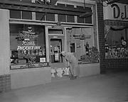 Y-580510A1.  Nick's Phoenix Inn, 1228 SW 3rd, SW 3rd & Main, May 10, 1958. 4:25 AM. Three toilets in doorway.