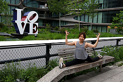 May 12, 2019 - New York City, New York, U.S. - A woman does yoga in front of artist Robert Indiana's pop art 'Love' sculpture on display along the High Line. The works can be seen at  Kasmin Galleries rooftop garden.  There are three sculptures with the word 'love', one in Spanish 'amor' and one in Hebrew (ahava) and one in English  (Credit Image: © Nancy Kaszerman/ZUMA Wire)