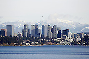 This scene of Bellevue and  the Cascade Mountains was taken looking across Lake Washington from Seattle's East Portal Viewpoint, a city park above the I-90 tunnel to the  bridge. (Logan Riely / The Seattle Times)