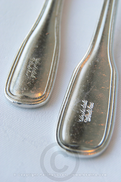 Detail of silver cutlery on a white linen table cloth with the name of the restaurant Ulriksdals Wärdshus inscribed Ulriksdal Ulriksdals Wärdshus Värdshus Wardshus Vardshus Restaurant, Stockholm, Sweden, Sverige, Europe