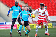 Doncaster Rovers forward Alex Kiwomya (23) battles for possession during the EFL Sky Bet League 1 match between Doncaster Rovers and Fleetwood Town at the Keepmoat Stadium, Doncaster, England on 17 February 2018. Picture by Mick Atkins.