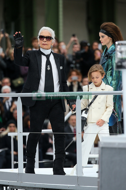 File photo - Karl Lagerfeld and Hudson Kroenig walk on the runway during the Chanel Fashion Show at FW17 held in Paris, France on March 7, 2017. Karl Lagerfeld died on Monday at age 85. One who may inherit is his godson Hudson. Hudson's dad, model Brad Kroenig, is like 'family' to Lagerfeld. Hudson began modeling for Chanel at age two and had continued to pop up on the runway ever since. Photo by Alain Gil Gonzalez /ABACAPRESS.COM