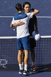 March 11, 2018 - Indian Wells, CA, U.S. - INDIAN WELLS, CA - MARCH 11: Taro Daniel (JPN) gets a hug from the tenth seed Novak Djokovic (SRB) after Daniel defeated Djokovic in three sets to advance to the next round of the BNP Paribas Open during a match played on March 11, 2018 at the Indian Wells Tennis Garden in Indian Wells, CA. (Photo by John Cordes/Icon Sportswire) (Credit Image: © John Cordes/Icon SMI via ZUMA Press)