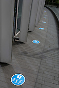 """Social distance markers are on the ground at the entrance to the Roof Garden for when this popular rooftop viewpoint across the capital re-opens again when restrictions of the UK Coronavirus pandemic lockdown rules are realxed further. The number of deaths from Coronavirus in the last 24hrs has increased by 287 to 37,979 while the UK government lowered the national Covid-19 alert level from 4 to 3, meaning the virus is considered to be """"in general circulation .. with """"a gradual reduction in restrictions"""", on 19th June 2020, in the City of London, England."""