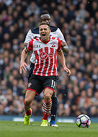 Football - 2016 / 2017 Premier League - Tottenham Hotspur vs. Southampton<br /> <br /> Dusan Tadic of Southampton winces in pain after being caught by Wanyama of Tottenham at White Hart Lane <br /> <br /> COLORSPORT/DANIEL BEARHAM