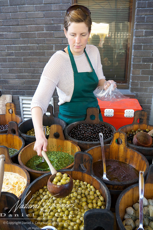Getting the olives for a customer at the Farmers Market in Galway, Ireland.