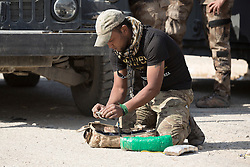 Licensed to London News Pictures. 23/10/2016. An Iraqi Army engineer defuses a suicide belt found in a local house in the recently liberated town of Bartella, Iraq.<br /> <br /> Bartella, a mainly Christian town with a population of around 30,000 people before being taken by the Islamic State in August 2014, was captured two days ago by the Iraqi Army's Counter Terrorism force as part of the ongoing offensive to retake Mosul. Although ISIS militants were pushed back a large amount of improvised explosive devices are still being found in the town's buildings. Photo credit: Matt Cetti-Roberts/LNP