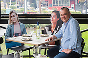 Sydney, Australia. Friday 15th May 2020. A restaurant in Sydney's inner west called Five Dock Dining has added cardboard cutouts of people to dining tables in order to create a better atmosphere for diners. Owner Frank Angilletta seen with the cutouts of people at several tables. Cafes, restaurants, and hotel dining areas are able to reopen  today but can only serve 10 guests at a time as the coronavirus pandemic restrictions ease.